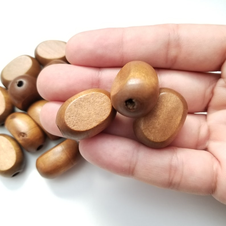 Flat oval wood beads Dark Brown hand cut 25x20mm hand cut wood flat oval beads 25x20mm